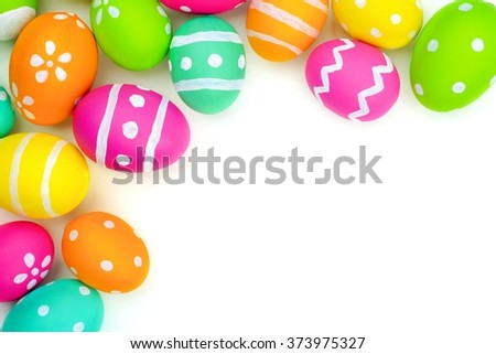 Colorful Easter egg top corner border against a white background - stock photo