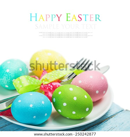 colorful easter eggs and cutlery isolated on white background. The text serves as an example and can be easily removed - stock photo
