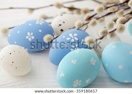 colorful easter eggs and pussy willow branches - stock photo