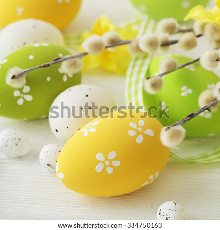 colorful easter eggs and willow branches - stock photo