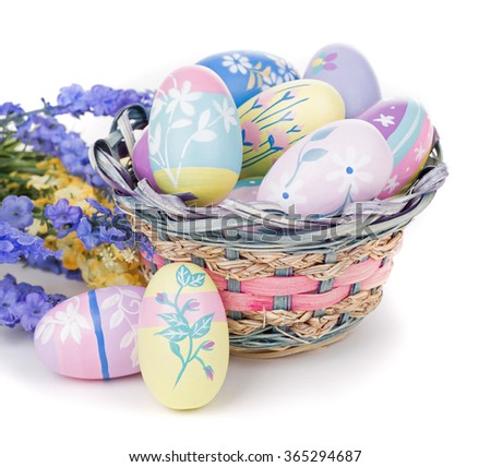 Colorful Easter eggs flowers and basket on a white background - stock photo