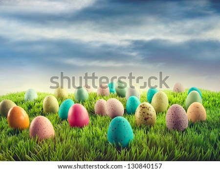 Colorful Easter eggs in grass - stock photo