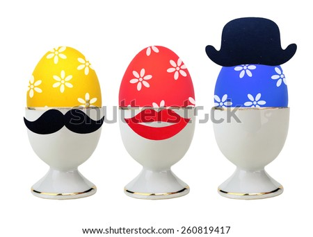 Colorful Easter Eggs in stand isolated on white - stock photo