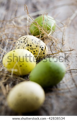 Colorful easter eggs on old wooden background - stock photo