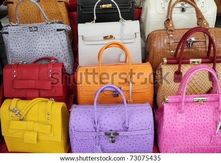 colorful elegant leather hand bags collection on Mercato di San Lorenzo ( Mercato Centrale ) in Florence, Italy, Europe - stock photo