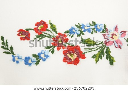 colorful embroidery with flowers - stock photo