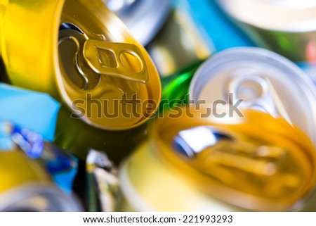 colorful empty beer cans - recyclable metal waste  - stock photo