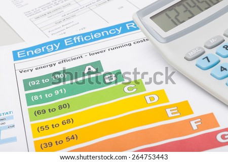 Colorful energy efficiency chart and calculator - stock photo