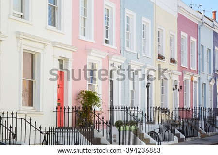 Colorful English houses facades, pastel pale colors in London  - stock photo