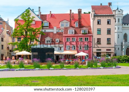 Colorful European cafeteria building and terrace - stock photo