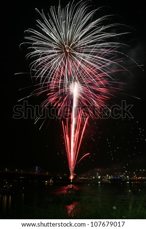 Colorful exploding fireworks over Ohio River seen from downtown Louisville - stock photo