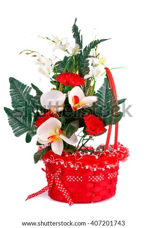 Colorful fabric flowers in wicker basket isolated on white background. - stock photo