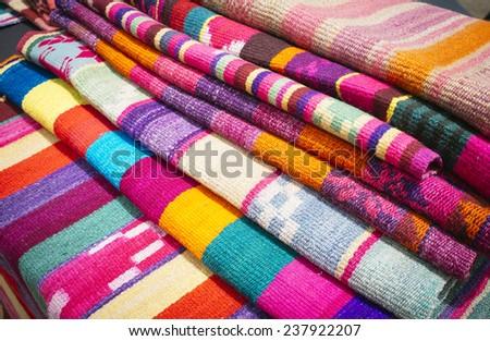 colorful fabrics woven loom indijena Latin American crafts - stock photo