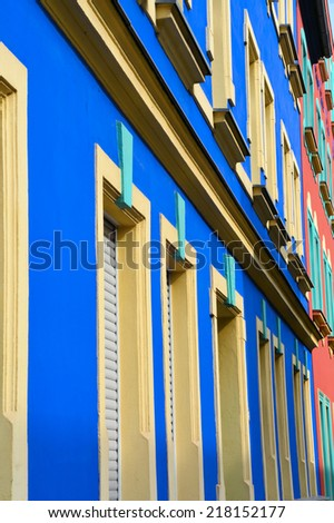 colorful facade of an old house - stock photo