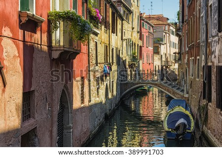 Colorful facades of old houses. Venice is a popular tourist destination of Europe - stock photo