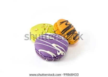 Colorful fancy macaroons on white background - stock photo