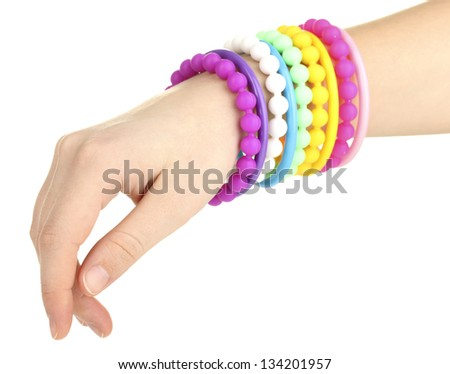 Colorful fashion bracelets on woman hand isolated on white - stock photo