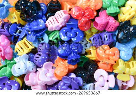 Colorful fashionable hair bands or clips, whole background - stock photo