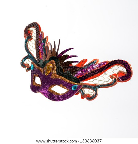 Colorful feathered Mardi Gras masquerade mask isolated on white background - stock photo