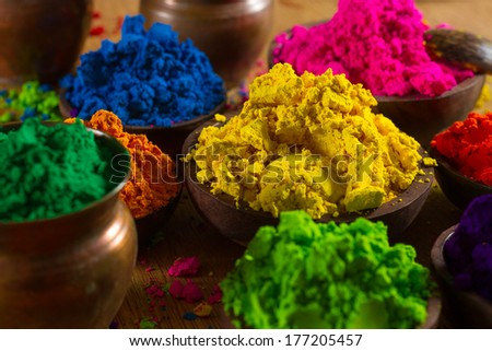Colorful, finely powdered Indian pigments. Focus on yellow. - stock photo