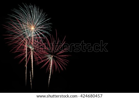 Colorful fireworks display isolated on black background. New Year beautiful holiday firework for celebration. - stock photo