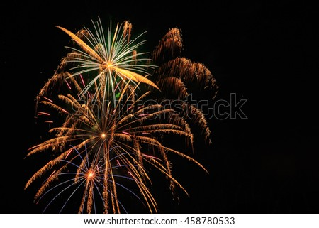 Colorful fireworks in night sky with copy space. - stock photo