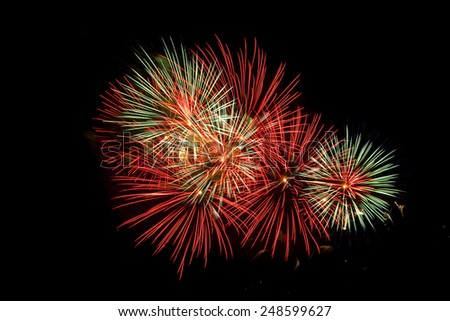 Colorful fireworks on a night sky background. - stock photo