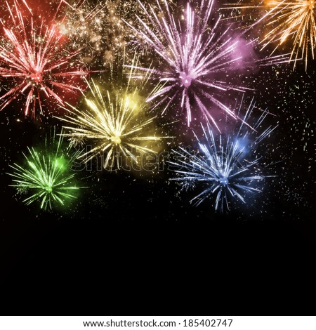 Colorful fireworks on dark background - stock photo