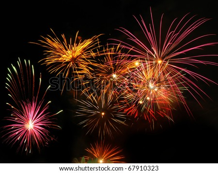 Colorful fireworks over dark sky, displayed during a celebration event - stock photo