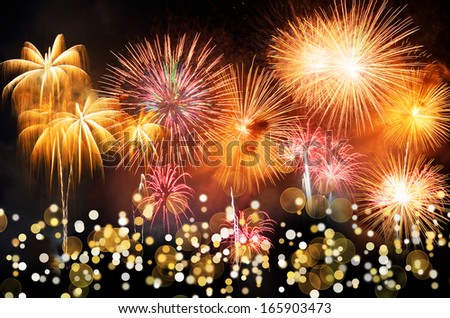 Colorful fireworks with bokeh. Fireworks are a class of explosive pyrotechnic devices used for entertainment purposes. Visible noise due to low light, soft focus, shallow DOF, slight motion blur - stock photo
