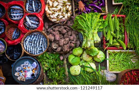 Colorful fish and vegetables can be purchased at the Ubud, Bali public market in the cultural heart of this fantastic Indonesian island. - stock photo