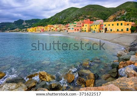 Colorful fisherman's houses on the sand beach lagoon on italian Riviera in Varigotti, Savona, Liguria, Italy - stock photo