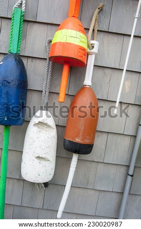Colorful fishing floats hanging on wall. - stock photo