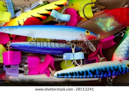 Colorful fishing saltwater fish lures in a box, rusted hooks - stock photo