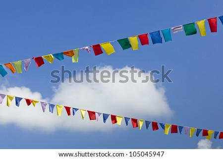 Colorful flags in the air, useful as background - stock photo