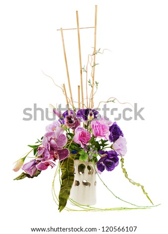colorful floral bouquet of roses, lilies and orchids arrangement centerpiece in vase isolated on white background - stock photo