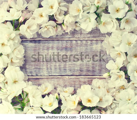colorful floral frame on rustic wooden background/spring or summer background - stock photo