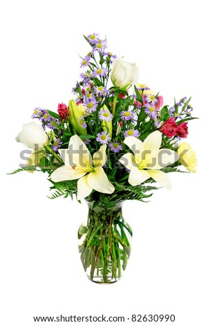 Colorful flower arrangement centerpiece  in glass vase with roses, daisies and lilies isolated on white - stock photo