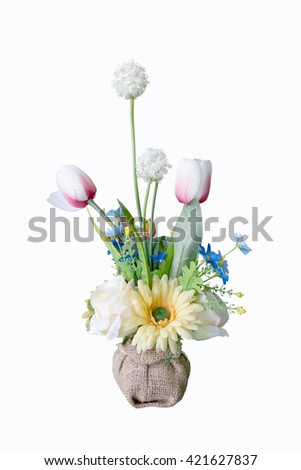 Colorful flower bouquet arrangement centerpiece in vase isolated on white. - stock photo