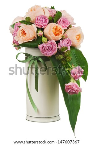 Colorful flower bouquet from roses and peon flowers in vase isolated on white background. Closeup. - stock photo