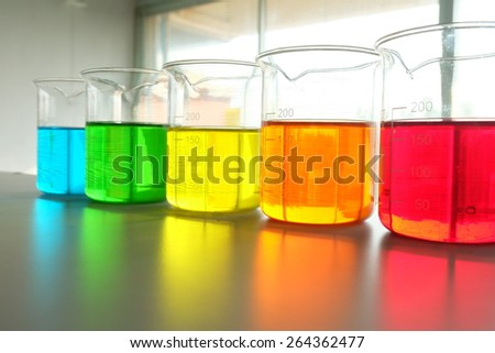 Colorful fluid in beaker for laboratory use   - stock photo