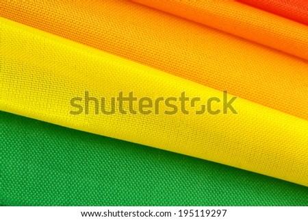 Colorful folded fabric, macro image. - stock photo