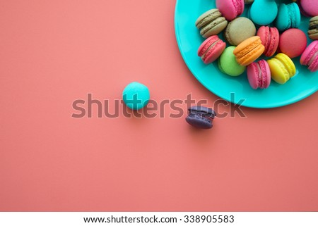 Colorful france macarons on pink background - stock photo