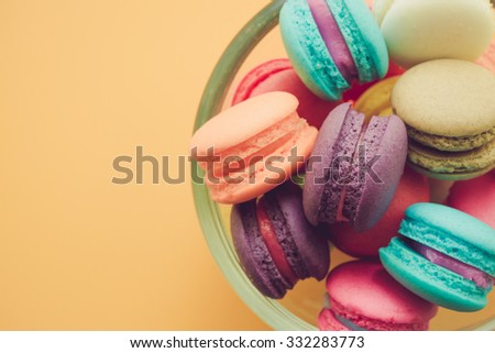 Colorful france macarons on yellow background - Retro filter effect & selective focus - stock photo