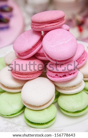Colorful French macarons on plate. - stock photo