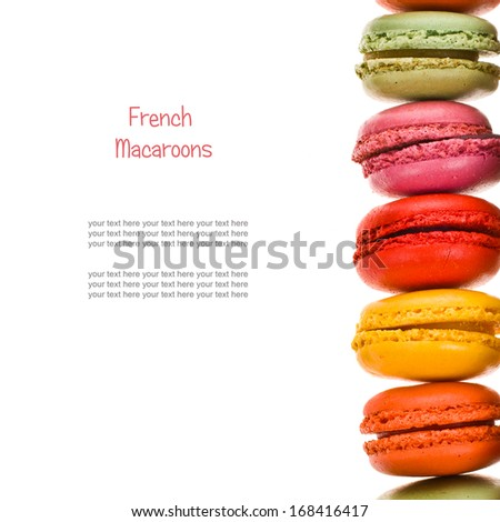 Colorful french macaroons frame  isolated on white background - stock photo
