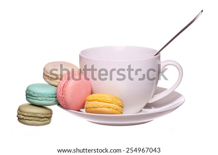Colorful French Macaroons with Cup of Tea isolated on white - stock photo