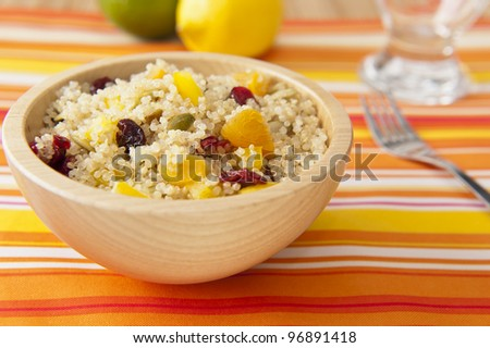 Colorful fruit and quinoa salad with pumpkin seeds - stock photo