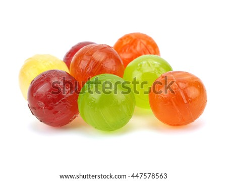 Colorful fruit candies on a white background - stock photo