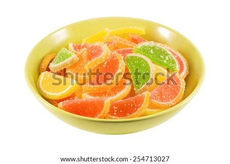 colorful fruit jelly candies on green bowl isolated on white background - stock photo
